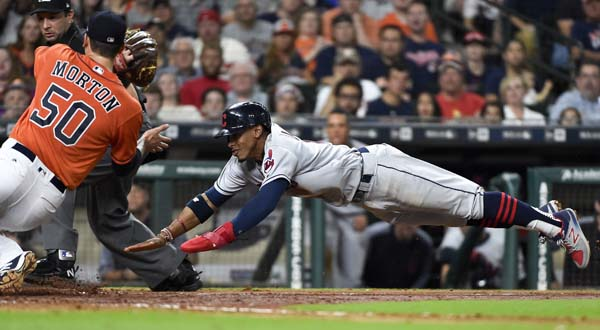 "<div class=""meta image-caption""><div class=""origin-logo origin-image ap""><span>AP</span></div><span class=""caption-text"">Francisco Lindor, right, attempts to score past Houston Astros starting pitcher Charlie Morton  (AP Photo/Eric Christian Smith) (AP)</span></div>"