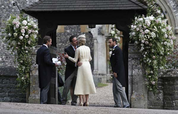 <div class='meta'><div class='origin-logo' data-origin='AP'></div><span class='caption-text' data-credit='AP'>Spencer Matthews, second left, is greeted by Donna Air as James Middleton, right, looks on at the entrance of St Mark's Church  (AP Photo/Kirsty Wigglesworth, Pool)</span></div>