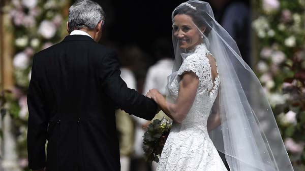 <div class='meta'><div class='origin-logo' data-origin='AP'></div><span class='caption-text' data-credit='AP'>Pippa Middleton, right, is escorted by her father Michael Middleton, as she arrives for her wedding to James Matthews (Justin Tallis/Pool Photo via AP)</span></div>