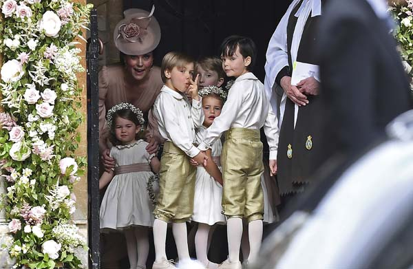 <div class='meta'><div class='origin-logo' data-origin='AP'></div><span class='caption-text' data-credit='AP'>Britain's Kate, Duchess of Cambridge, left, stands with her daughter Princess Charlotte, and other bridesmaids and pageboys prior to the wedding(Justin Tallis/Pool Photo via AP)</span></div>