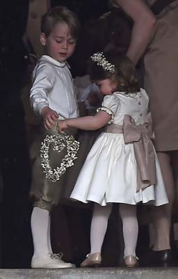 <div class='meta'><div class='origin-logo' data-origin='AP'></div><span class='caption-text' data-credit='AP'>Britain's Prince George, left and Princess Charlotte arrive for the wedding of their aunt Pippa Middleton to James Matthews, at St Mark's(Justin Tallis/Pool Photo via AP)</span></div>