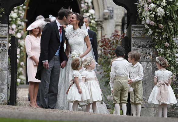 <div class='meta'><div class='origin-logo' data-origin='AP'></div><span class='caption-text' data-credit='AP'>Pippa Middleton and James Matthews kiss after their wedding at St Mark's Church (AP Photo/Kirsty Wigglesworth, Pool)</span></div>