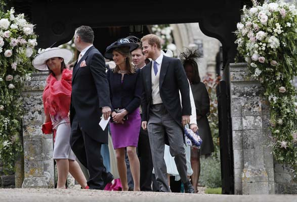 <div class='meta'><div class='origin-logo' data-origin='none'></div><span class='caption-text' data-credit='AP'>Britain's Prince Harry, right, leaves after the wedding of Pippa Middleton and James Matthews (AP Photo/Kirsty Wigglesworth, Pool)</span></div>