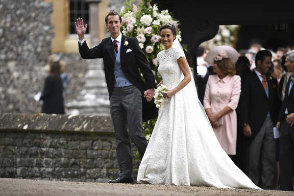 <div class='meta'><div class='origin-logo' data-origin='none'></div><span class='caption-text' data-credit='AP'>Pippa Middleton, centre right, walks with James Matthews after their wedding (Justin Tallis/Pool Photo via AP)</span></div>