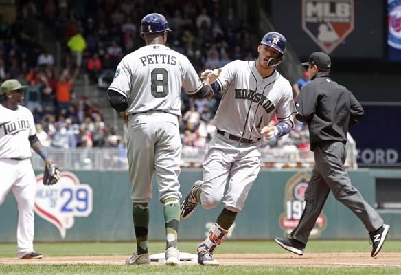 "<div class=""meta image-caption""><div class=""origin-logo origin-image ap""><span>AP</span></div><span class=""caption-text"">Houston Astros' Carlos Correa, right, rounds third on a solo home run off Minnesota Twins pitcher Ervin Santana (AP Photo/Jim Mone) (AP)</span></div>"