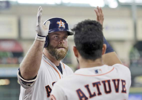 "<div class=""meta image-caption""><div class=""origin-logo origin-image ap""><span>AP</span></div><span class=""caption-text"">Houston Astros' Brian McCann, left, is congratulated by Jose Altuve after hitting a home run against the Los Angeles Angels (AP Photo/David J. Phillip) (AP)</span></div>"