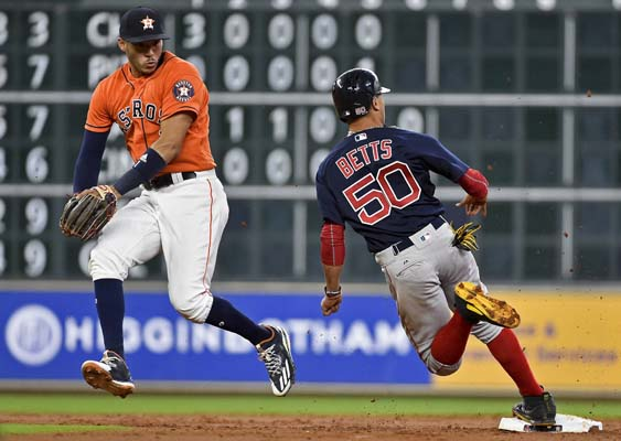 "<div class=""meta image-caption""><div class=""origin-logo origin-image ap""><span>AP</span></div><span class=""caption-text"">Astros shortstop Carlos Correa, left, leaps out of the way of Red Sox's Mookie Betts as Betts rounds second on Dustin Pedroia's single (AP Photo/Eric Christian Smith) (AP)</span></div>"