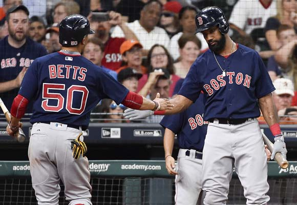 "<div class=""meta image-caption""><div class=""origin-logo origin-image ap""><span>AP</span></div><span class=""caption-text"">Boston Red Sox's Mookie Betts (50) celebrates with Xander Bogaerts after scoring on a run on Mitch Moreland's RBI-single (AP Photo/Eric Christian Smith) (AP)</span></div>"