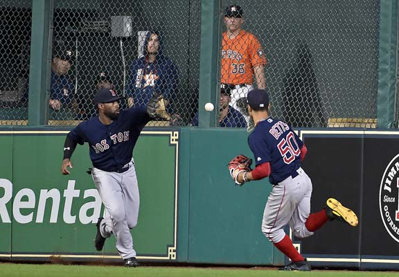 "<div class=""meta image-caption""><div class=""origin-logo origin-image ap""><span>AP</span></div><span class=""caption-text"">Boston Red Sox center fielder Jackie Bradley Jr., left, fields a double by Houston Astros' Yuli Gurriel as right fielder Mookie Betts watches (AP Photo/Eric Christian Smith) (AP)</span></div>"