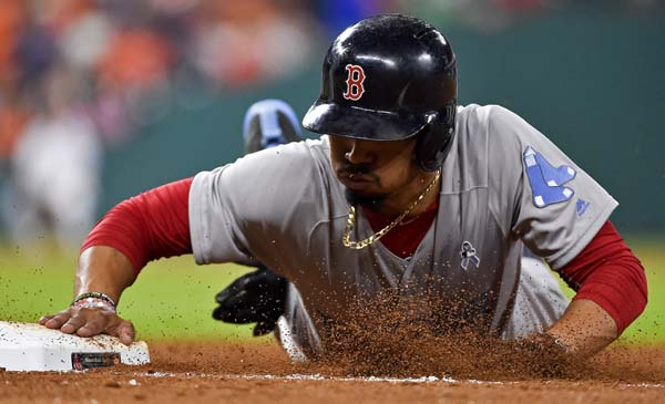 "<div class=""meta image-caption""><div class=""origin-logo origin-image ap""><span>AP</span></div><span class=""caption-text"">Boston Red Sox's Mookie Betts dives back to first on a pickoff-attempt during the sixth inning of a baseball game against the Houston Astros, (AP Photo/Eric Christian Smith) (AP)</span></div>"