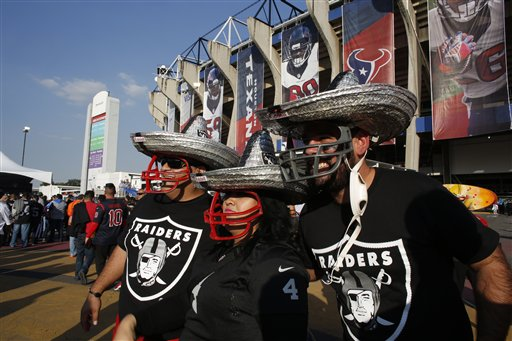 <div class='meta'><div class='origin-logo' data-origin='AP'></div><span class='caption-text' data-credit='AP Photo/Dario Lopez-Mills'>Oakland Raiders fans look at Azteca Stadium before an NFL football game against the Houston Texans Monday, Nov. 21, 2016, in Mexico City.</span></div>