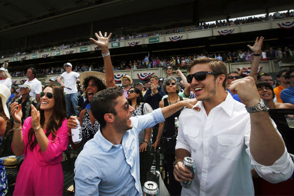 "<div class=""meta image-caption""><div class=""origin-logo origin-image none""><span>none</span></div><span class=""caption-text"">Spectators cheer as horses cross the finish line in the fifth race of the day prior to the 147th running of the Belmont Stakes horse race at Belmont Park (AP Photo/ Jason DeCrow)</span></div>"