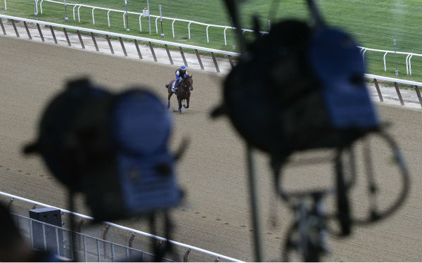"<div class=""meta image-caption""><div class=""origin-logo origin-image none""><span>none</span></div><span class=""caption-text"">Television broadcast lights hang from the rafters of the grandstand at Belmont Park as Kentucky Derby and Preakness winner American Pharoah. (AP Photo/ Julie Jacobson)</span></div>"