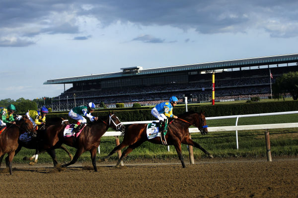 "<div class=""meta image-caption""><div class=""origin-logo origin-image none""><span>none</span></div><span class=""caption-text"">American Pharoah (5) leads the field entering turn three on the way to a Triple Crown victory during the 147th running of the Belmont Stakes horse race at Belmont Park. (AP Photo/ Jason DeCrow)</span></div>"