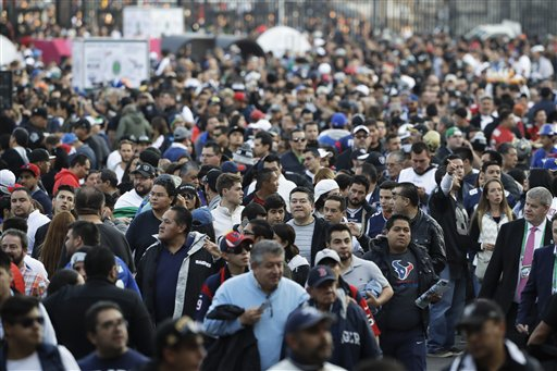 <div class='meta'><div class='origin-logo' data-origin='AP'></div><span class='caption-text' data-credit='AP Photo/Eduardo Verdugo'>Fans wait to enter Azteca Stadium before an NFL football game between the Houston Texans and the Oakland Raiders Monday, Nov. 21, 2016, in Mexico City.</span></div>
