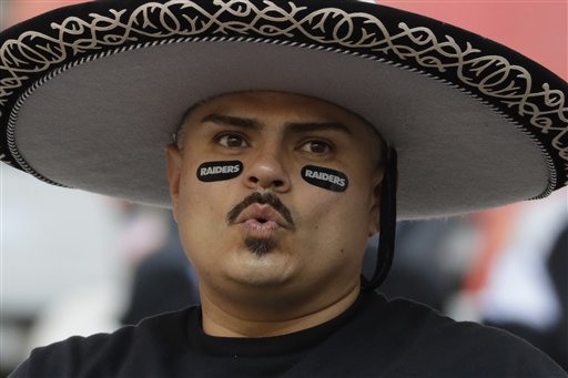 <div class='meta'><div class='origin-logo' data-origin='AP'></div><span class='caption-text' data-credit='AP Photo/Rebecca Blackwell'>A Oakland Raiders fan looks on before an NFL football game against the Houston Texans Monday, Nov. 21, 2016, in Mexico City.</span></div>
