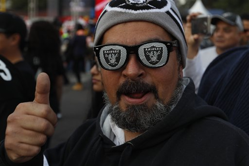 <div class='meta'><div class='origin-logo' data-origin='AP'></div><span class='caption-text' data-credit='AP Photo/Eduardo Verdugo'>Oakland Raiders fans take pictures in front of Azteca Stadium before an NFL football game against the Houston Texans Monday, Nov. 21, 2016, in Mexico City.</span></div>
