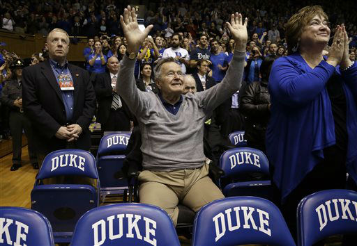 "<div class=""meta image-caption""><div class=""origin-logo origin-image none""><span>none</span></div><span class=""caption-text"">Former President George H.W. Bush is introduced during the first half of a college basketball game between Duke and NC State at Cameron Indoor Stadium Jan. 18, 2014.  (AP Photo/ Gerry Broome)</span></div>"