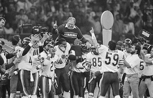 <div class='meta'><div class='origin-logo' data-origin='none'></div><span class='caption-text' data-credit='AP'>Chicago Bears defensive coordinator Buddy Ryan is carried off the field by the team after the Bears win 46-10, on Jan. 26, 1986 in New Orleans, to win Super Bowl XX. (AP Photo)</span></div>