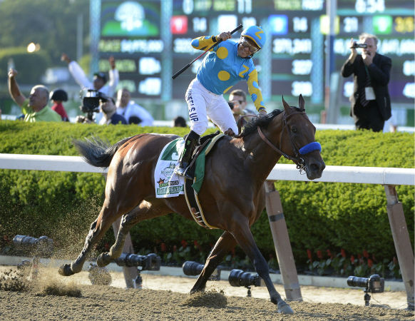 "<div class=""meta image-caption""><div class=""origin-logo origin-image none""><span>none</span></div><span class=""caption-text"">Victor Espinoza reacts after crossing the finish line with American Pharoah (5) to win the 147th running of the Belmont Stakes horse race at Belmont Park, Saturday, June 6, 2015  (AP Photo/ Bill Kostroun)</span></div>"