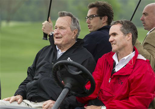 <div class='meta'><div class='origin-logo' data-origin='none'></div><span class='caption-text' data-credit='AP Photo/ Patric Schneider'>Former President George H. W. Bush attends the final round of the Houston Open golf tournament, Sunday, April 6, 2014, in Humble, Texas.</span></div>