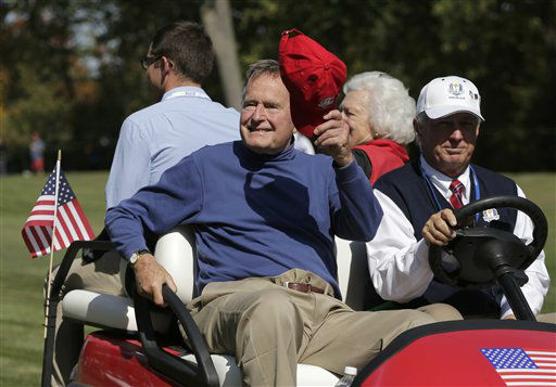 <div class='meta'><div class='origin-logo' data-origin='none'></div><span class='caption-text' data-credit='AP Photo/ Charlie Riedel'>Former President George H. W. Bush waves to the crowd on the fifth hole during a four-ball match at the Ryder Cup PGA golf tournament Saturday, Sept. 29, 2012.</span></div>