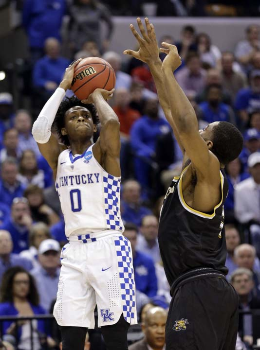 <div class='meta'><div class='origin-logo' data-origin='AP'></div><span class='caption-text' data-credit='AP'>Kentucky guard De'Aaron Fox (0) shoots over Wichita State forward Rashard Kelly (0) during the second half. (AP Photo/Michael Conroy)</span></div>