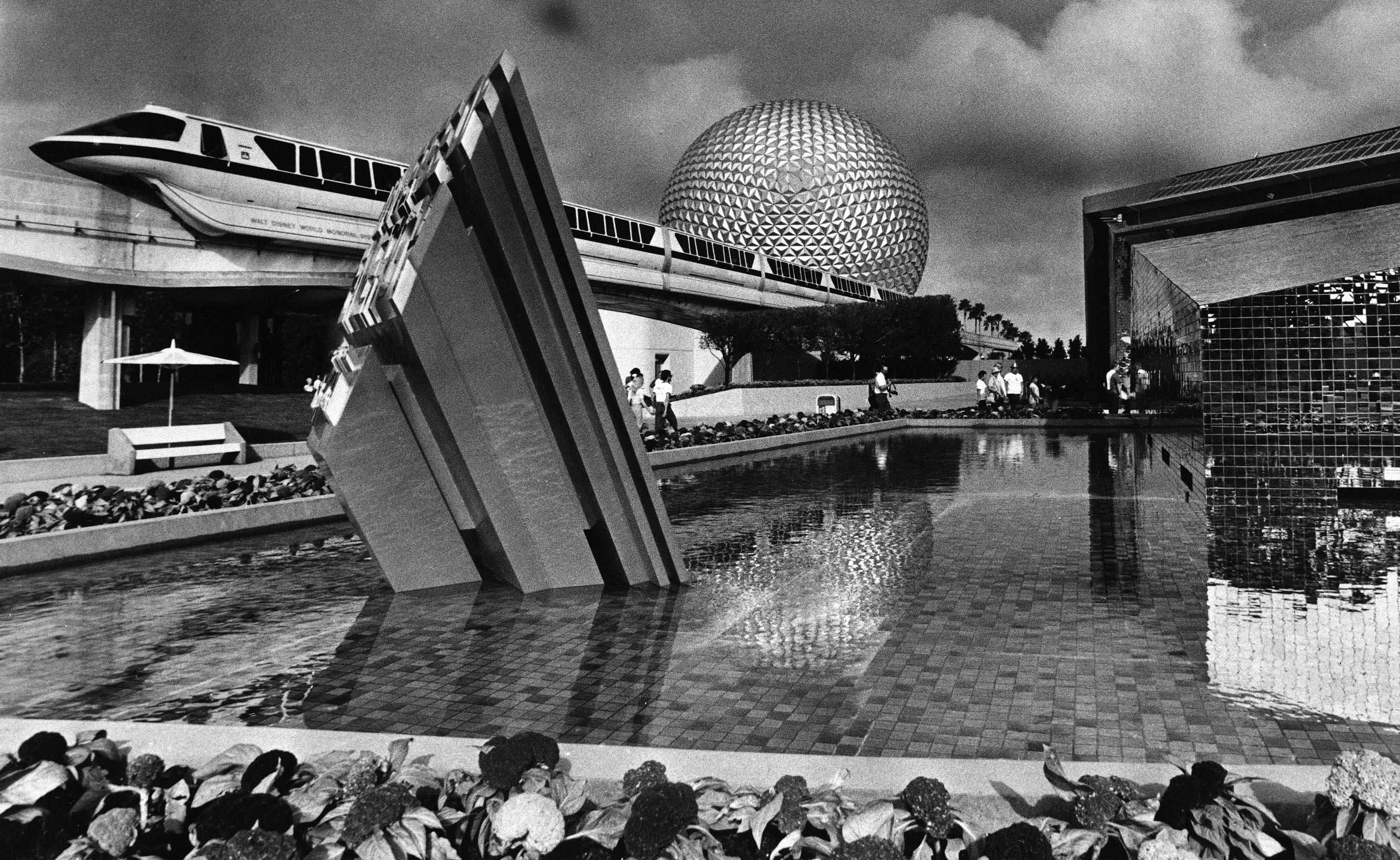 <div class='meta'><div class='origin-logo' data-origin='none'></div><span class='caption-text' data-credit='AP Photo/Ray Fairall'>The Disney monorail glides past Spaceship Earth after the official opening of the park Friday Oct. 1, 1982 in Lake Buena Vista, Fla.</span></div>