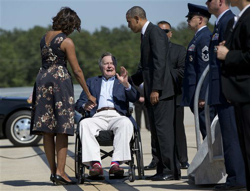 "<div class=""meta image-caption""><div class=""origin-logo origin-image none""><span>none</span></div><span class=""caption-text"">President Barack Obama and first lady Michelle Obama are greeted by former President George H.W. Bush at George Bush Intercontinental Airport April 9, 2014.  (AP Photo/ Carolyn Kaster)</span></div>"