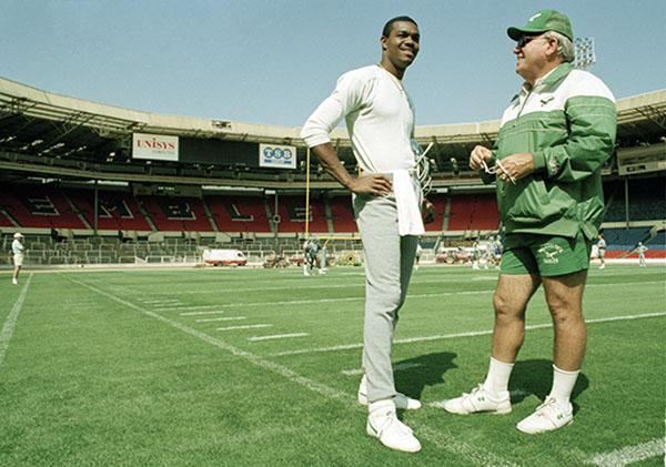 <div class='meta'><div class='origin-logo' data-origin='none'></div><span class='caption-text' data-credit='AP'>Randall Cunningham talks with head coach Buddy Ryan, 08/05/89, at London's Wembley Stadium where they will take on the Browns for the 1989 American Bowl. (AP Photo/Gillian Allen)</span></div>