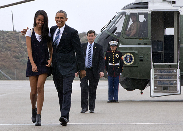 <div class='meta'><div class='origin-logo' data-origin='none'></div><span class='caption-text' data-credit='AP'>President Barack Obama walks with daughter Malia Obama through a light rain to from Marine One to board Air Force One April 8, 2016 (AP Photo/Jacquelyn Martin)</span></div>