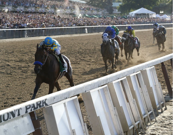 "<div class=""meta image-caption""><div class=""origin-logo origin-image none""><span>none</span></div><span class=""caption-text"">American Pharoah (5) with Victor Espinoza up leads the pack as he approaches the finish line during the 147th running of the Belmont Stakes horse race at Belmont Park (AP Photo/ Julio Cortez)</span></div>"