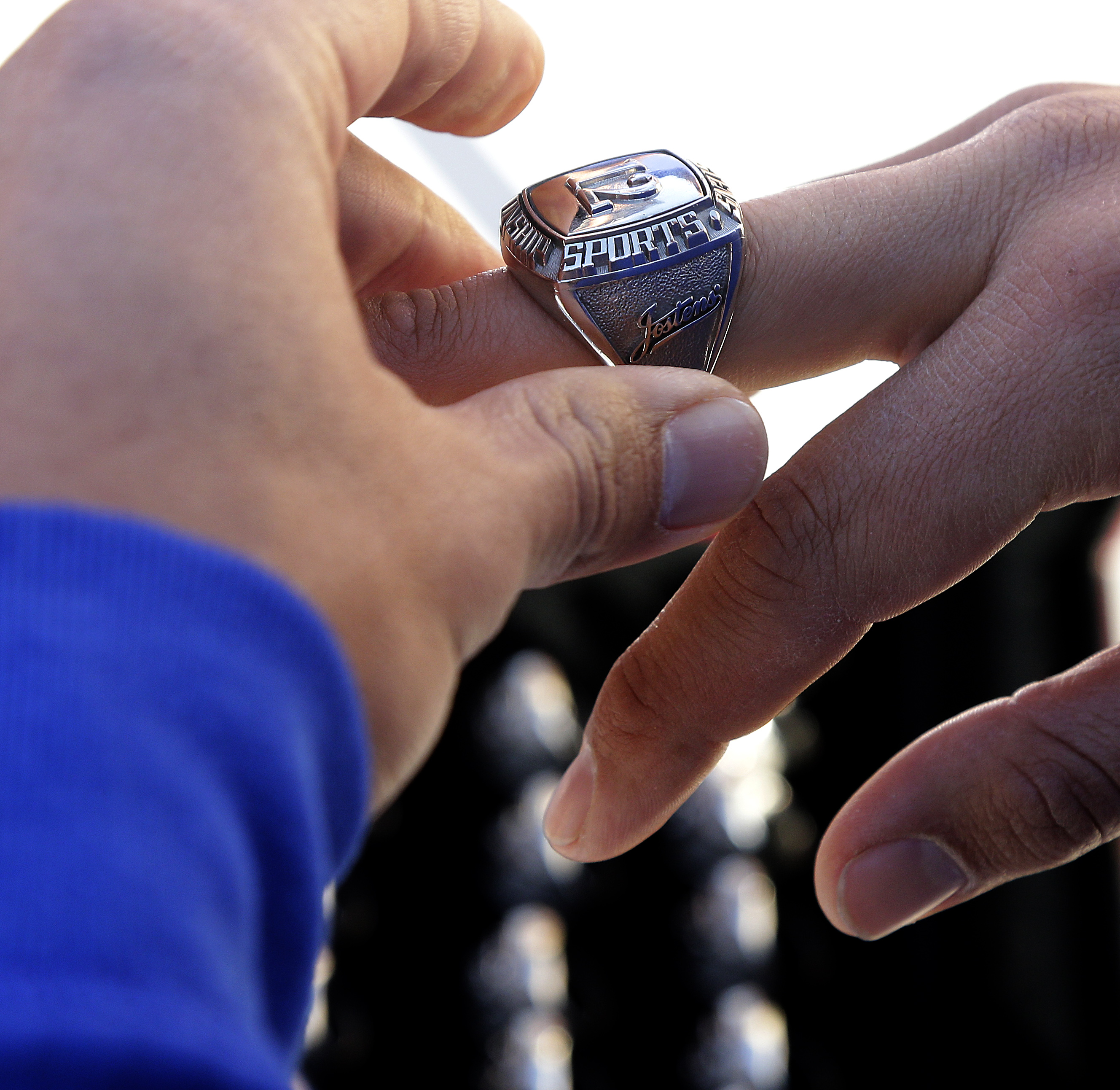 <div class='meta'><div class='origin-logo' data-origin='AP'></div><span class='caption-text' data-credit='AP Photo/Charlie Riedel'>Kansas City Royals' Jason Vargas is fitted for his World Series Championship ring during spring training baseball practice Tuesday, Feb. 23, 2016, in Surprise, Ariz.</span></div>