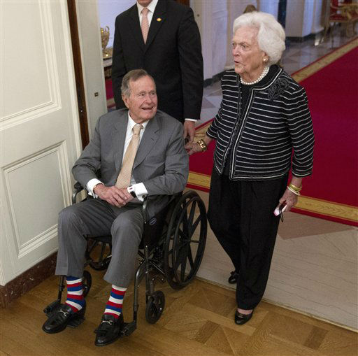 "<div class=""meta image-caption""><div class=""origin-logo origin-image none""><span>none</span></div><span class=""caption-text"">In this May 31, 2012 file photo, former President George H.W. Bush, left, and his wife, former first lady Barbara Bush, arrive in the East Room of the White House in Washington. (AP Photo/ Pablo Martinez Monsivais)</span></div>"