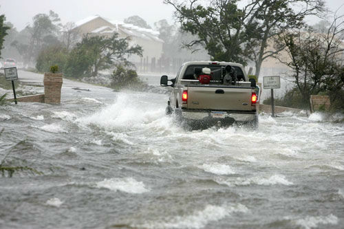 "<div class=""meta image-caption""><div class=""origin-logo origin-image none""><span>none</span></div><span class=""caption-text"">A vehicle makes its way through a flooded street from the overflowing  Grande Lagoon  in Pensacola, Fla., as Hurricane Katrina passes through the area, Monday, Aug. 29, 2005. (AP Photo/ PETER COSGROVE)</span></div>"