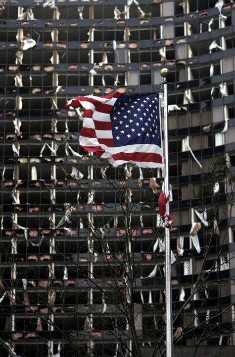 "<div class=""meta image-caption""><div class=""origin-logo origin-image none""><span>none</span></div><span class=""caption-text"">A tattered U.S. Flag flies in the foreground of the Hyatt, in New Orleans, Monday, Aug. 29, 2005, where dozens of windows were blown out when Hurricane Katrina made land fall. (Photo/ERIC GAY)</span></div>"