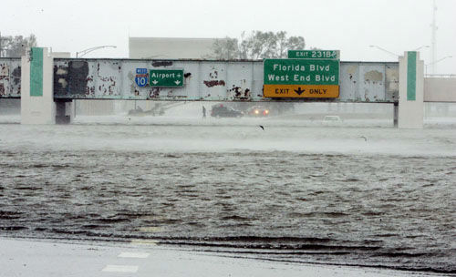 "<div class=""meta image-caption""><div class=""origin-logo origin-image none""><span>none</span></div><span class=""caption-text"">The Mound Underpass on Interstate-10 is flooded near downtown New Orleans on Monday, Aug. 29, 2005, as Hurricane Katrina dumped torrential rain. (Photo/BILL HABER)</span></div>"