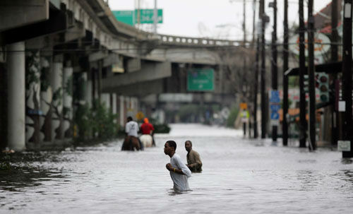 "<div class=""meta image-caption""><div class=""origin-logo origin-image none""><span>none</span></div><span class=""caption-text"">New Orleans residents walk through chest deep floodwater after Hurricane Katrina made landfall on the Louisiana coast on Monday, Aug. 29, 2005. (Photo/DAVE MARTIN)</span></div>"