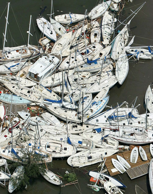 "<div class=""meta image-caption""><div class=""origin-logo origin-image none""><span>none</span></div><span class=""caption-text"">Boats damaged by Hurricane Katrina are stacked on top of one another Tuesday, Aug. 30, 2005 in New Orleans.  (Photo/DAVID J. PHILLIP)</span></div>"