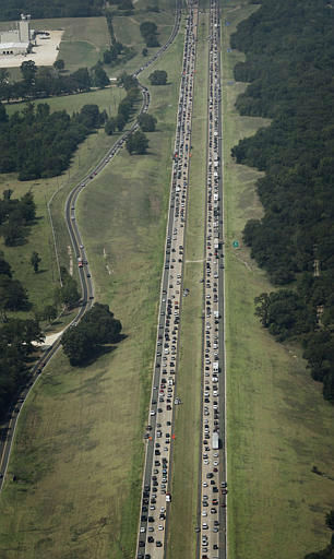 "<div class=""meta image-caption""><div class=""origin-logo origin-image none""><span>none</span></div><span class=""caption-text"">Hurricane Rita evacuees were trapped in gridlock for nearly 24 hours, September 2005. (AP Photo)</span></div>"
