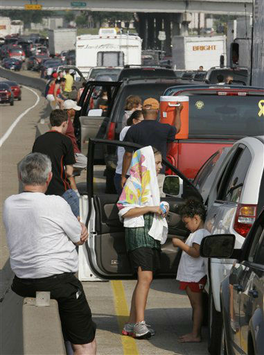 "<div class=""meta image-caption""><div class=""origin-logo origin-image none""><span>none</span></div><span class=""caption-text"">Hurricane evacuees stand by the side of their automobiles on Highway 290 leading out of Houston in this Sept. 22, 2005 file photo. (AP Photo/Ron Heflin) (AP Photo/ RON HEFLIN)</span></div>"