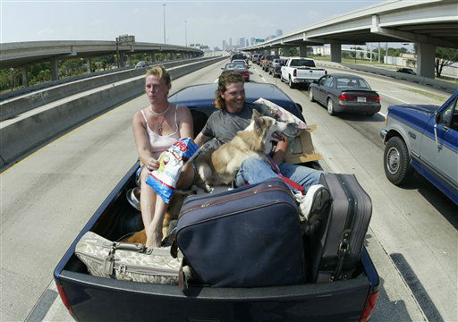 "<div class=""meta image-caption""><div class=""origin-logo origin-image none""><span>none</span></div><span class=""caption-text"">Cherlyn, left, and Lane McWhorter of Baycliff, TX ride in the back of a pickup truck with their animals in Houston, Thursday, Sept. 22, 2005. (AP Photo/Rick Bowmer) (AP Photo/ RICK BOWMER)</span></div>"