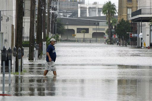 <div class='meta'><div class='origin-logo' data-origin='none'></div><span class='caption-text' data-credit='AP Photo/ Matt Slocum'>Rudy Betancourt walks through a flooded street after boarding up his business in downtown Galveston, Texas, as Hurricane Ike approaches, Friday, Sept. 12, 2008.</span></div>