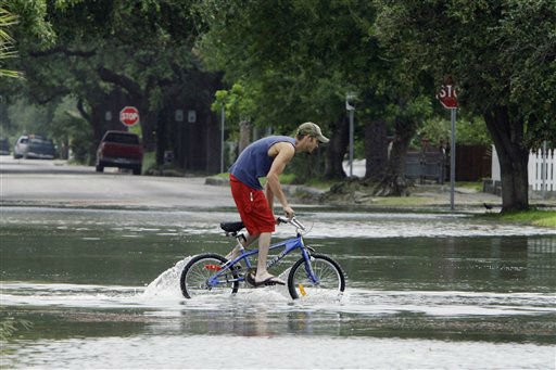 <div class='meta'><div class='origin-logo' data-origin='none'></div><span class='caption-text' data-credit='AP Photo/ Matt Slocum'>A person rides his bike through a flooded street near downtown Galveston, Texas, as Hurricane Ike approaches the Texas coast, Friday, Sept. 12, 2008. (AP Photo/Matt Slocum)</span></div>