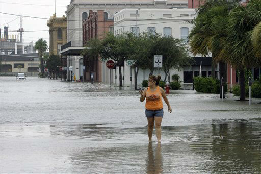 <div class='meta'><div class='origin-logo' data-origin='none'></div><span class='caption-text' data-credit='AP Photo/ Matt Slocum'>Estella Morales walks through a flooded street after checking on a friend's business in downtown Galveston, Texas, as Hurricane Ike approaches, Friday, Sept. 12, 2008.</span></div>