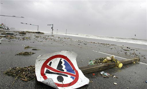 <div class='meta'><div class='origin-logo' data-origin='none'></div><span class='caption-text' data-credit='AP Photo/ LM Otero'>Debris brought ashore by waves created by Hurricane Ike lay on the road atop the sea wall in Galveston, Texas, Friday, Sept. 12, 2008.</span></div>