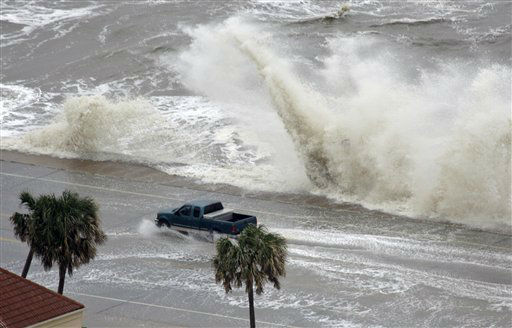 <div class='meta'><div class='origin-logo' data-origin='none'></div><span class='caption-text' data-credit='AP Photo/ David J. Phillip'>A truck drives along the seawall as waves crash over the partially flooded road as Hurricane Ike approaches Friday, Sept. 12, 2008 in Galveston, Texas. (AP Photo/David J. Phillip)</span></div>