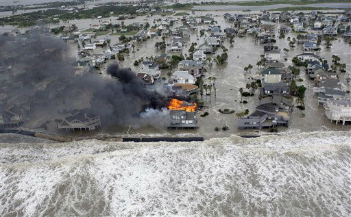 <div class='meta'><div class='origin-logo' data-origin='none'></div><span class='caption-text' data-credit='AP Photo/ David J. Phillip'>Fire destroys homes along the beach on Galveston Island, Texas as Hurricane Ike approaches Friday, Sept. 12, 2008. (AP Photo/David J. Phillip)</span></div>