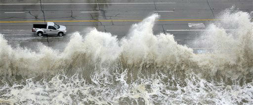 <div class='meta'><div class='origin-logo' data-origin='none'></div><span class='caption-text' data-credit='AP Photo/ David J. Phillip'>A truck drives along the seawall past crashing waves as Hurricane Ike approaches Friday, Sept. 12, 2008 in Galveston, Texas. (AP Photo/David J. Phillip)</span></div>