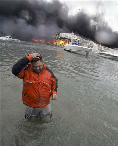 <div class='meta'><div class='origin-logo' data-origin='none'></div><span class='caption-text' data-credit='AP Photo/ LM Otero'>With Hurricane Ike offshore, Michael Gardner walks in high water in front of a burning marina warehouse in Galveston, Texas, Friday, Sept. 12, 2008.</span></div>